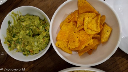 Nacho chips with guacamole dip